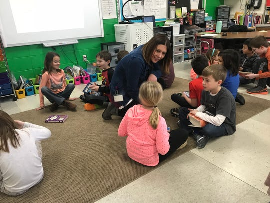 Michelle Loewenhagen,talks to second-graders Grace
