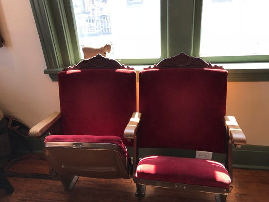 Old theater seats at the Little Goat come from the
