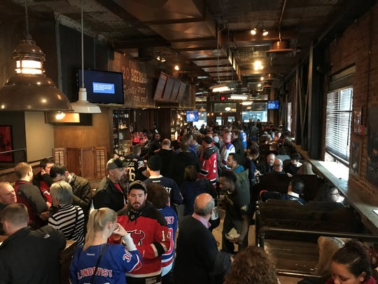 Fans gather to catch the game at Dinosaur Bar-B-Que in Newark.