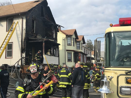 Fire fighters on the scene of a home fire on Union Street in Boonton. April 11, 2018