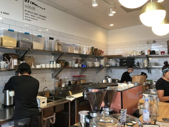 FOLK cafe and coffee shop has bright light and an open kitchen.