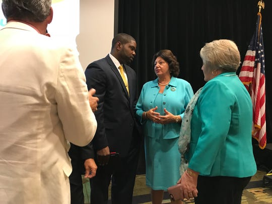 State Sen. Kathleen Passidomo, R-Naples, and Rep. Byron Donalds, of Naples, huddle at a Wake Up Naples chamber breakfast on Wednesday, April 11, 2018.