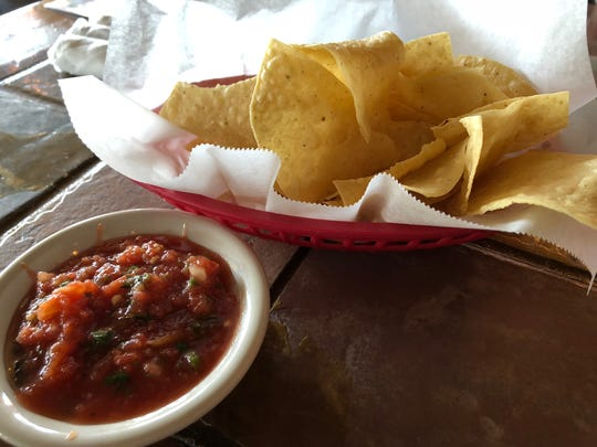 Chips are served warm for the table with a side of house-made salsa.
