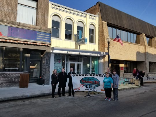 Posing after the reveal are, from left are Amy Hansen of the Downtown Fond du Lac Partnership, Rep. Jeremy Thiesfeldt, Alan Hathaway, Fond du Lac City Manager Joe Moore behind Annie Culver, owner, and Lt. Gov. Rebecca Kleefisch.