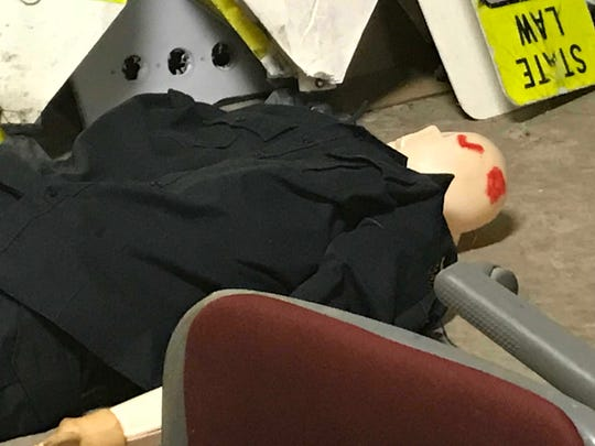 """A mannequin shows two head """"wounds"""" for a mock crime scene for Citizens Academy April 10, 2018."""