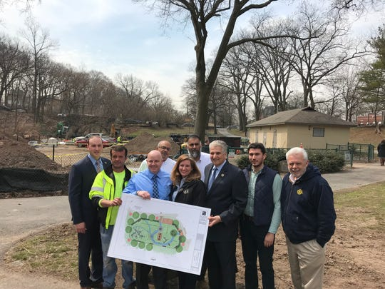 Essex County Executive Joseph DiVincenzo, right of rendering, joins others on Thursday, April 12, to announce the nearly $1 million modernization of Yanticaw Park's playground in Nutley.