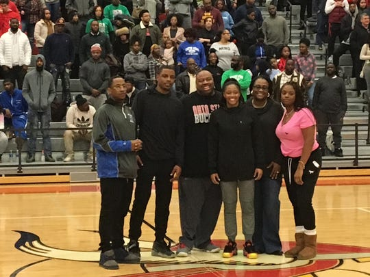 Kevin Mitchell, Cameron Mitchell, Mark Mitchell, Kelsey Mitchell, Cheryl Mitchell, and Chelsea Mitchell receive a standing ovation as Princeton High School retires Kelsey?s jersey number. Provided