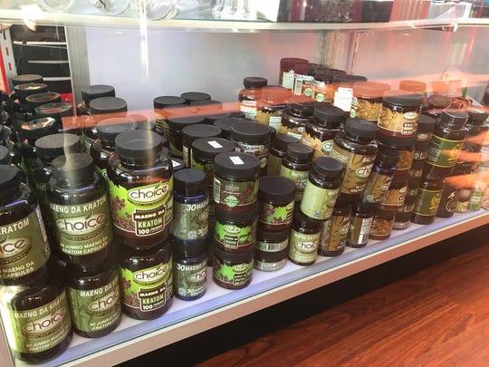 Bottles of kratom capsules at Lotus Vape & Smoke Shop