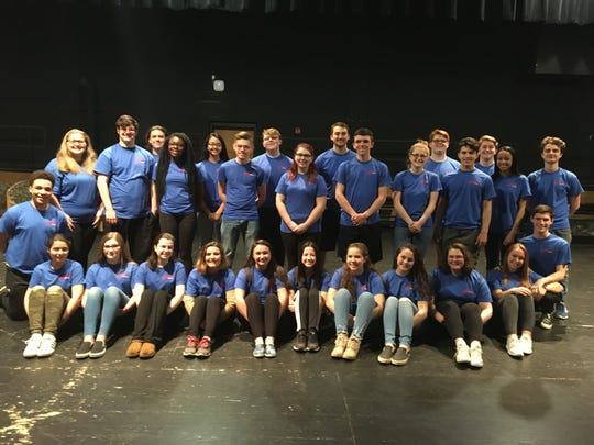 """The cast of Millville High School's production of the musical """"Footloose"""" gathers for a photo."""