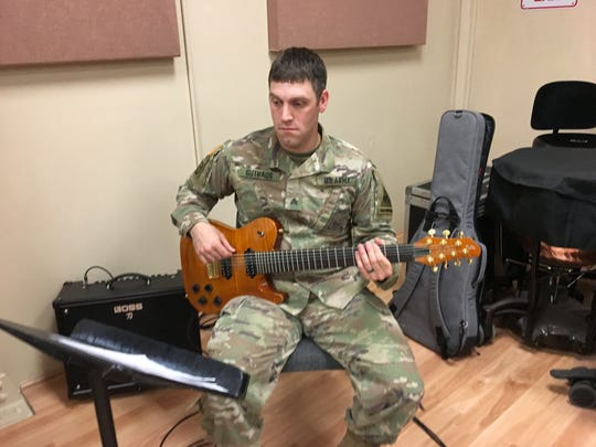 Sgt. Kirk Guthaus plays guitar for the 1st Armored Division Band. Here, he rehearses Arabic music before an April 28 concert at UTEP.