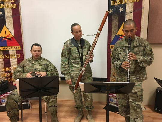 From left, Sgt. 1st Class George Padilla, 1st Sgt. Tracie Whitelaw and Sgt. Alexander Houston rehearse some Arabic music at Fort Bliss. The 1st Armored Division Band recently got back from a deployment to the Middle East.