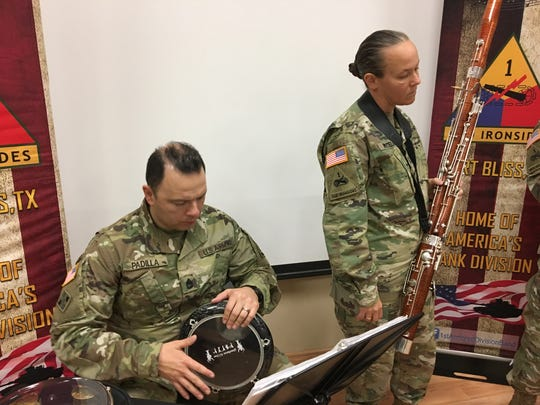 Sgt. 1st Class George Padilla, left, and 1st Sgt. Tracie Whitelaw rehearse Arabic music at Fort Bliss. The band learned some Arabic music before its recent deployment to the Middle East and will partner with UTEP's Arabic music ensemble, Layali Al-Sham, during a spring concert April 28.