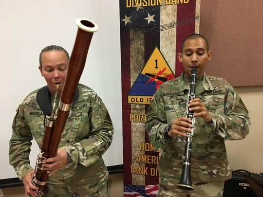 First Sgt. Tracie Whitelaw, left, and Sgt. Alexander Houston rehearse some Arabic music before their April 28 concert. The band will partner with UTEP's Arabic music ensemble during the concert at the Fox Fine Arts Recital Hall.