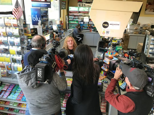 An attendant speaks to reporters after the NJ Lottery announced the winning Mega Millions ticket, worth $533 million, was sold at the Lukoil station on Route 23 south in Riverdale. The winner would not come forward until two weeks after the drawing.