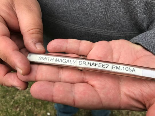 Smith carries his mother's hospital bracelet with him