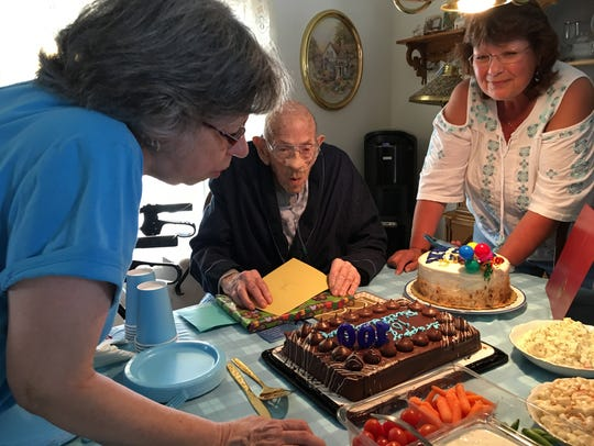 Jack Wolfe gets help blowing out the candles from family.