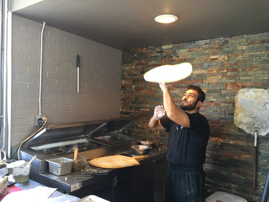 Sami Ihmaidan hand-tosses every pizza at Sami's Brick Oven Pizzeria in Murfreesboro.