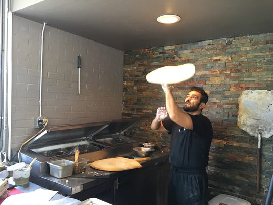 Sami Ihmaidan hand-tosses every pizza at Sami's Brick Oven Pizzeria in Murfreesboro.