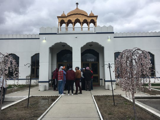 Members of the Gurdwara Sikh Temple stand outside the