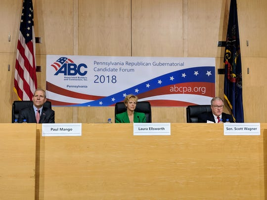 State Sen. Scott Wagner, right, delivers opening remarks during a forum for Republican candidates for governor on April 16, 2018. Paul Mango, left, and Laura Ellsworth also participated.