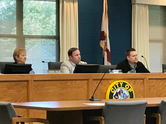 Milton City Councilwoman Sharon Holley, Milton Mayor Wesley Meiss and councilman Casey Powell listen to a presentation from former Pensacola and Gulf Breeze City Manager Steve Garman on Milton's options for finding a new city manager during a special meeting on Monday, April 16, 2018 at Milton City Hall.