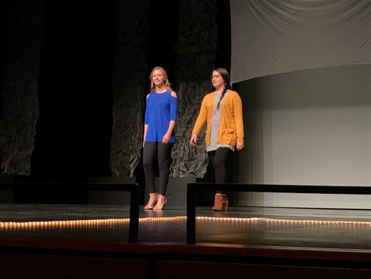 Katie Tomsyck works with Sophia Wojahn on stage during