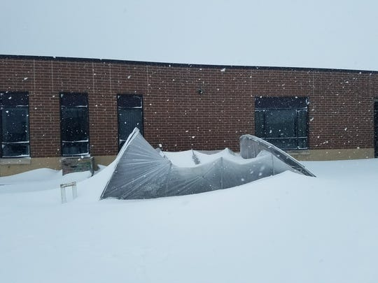 The framework of this 20x12-foot hoop house at Winneconne High School collapsed under the weight of the snow.