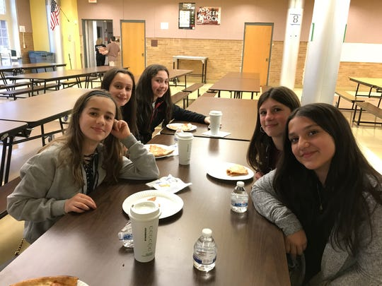 "Clockwise from left, Ava Iannitelli, Angelina Burgos, Ava Oliver, Anna Green and Gianna Pizzano enjoy pizzas on April 17, 2018, before joining their mothers for the ""Finding Kind"" screening in Nutley."