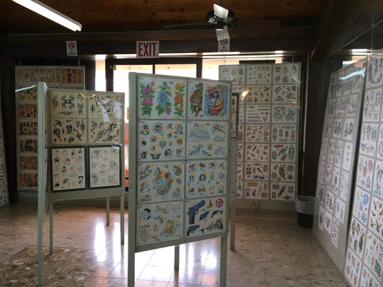 Tattoo designs are displayed at Harv Angel's Low Tide