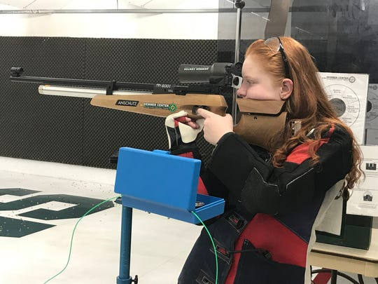Lillian Warren, 14, of Perry is among the youngest competitors at the Junior Olympics in Colorado Springs, Colorado this month. She competes in smallbore (.22 caliber rifle) and air rifle categories. She practices with an air rifle April 10, 2018.