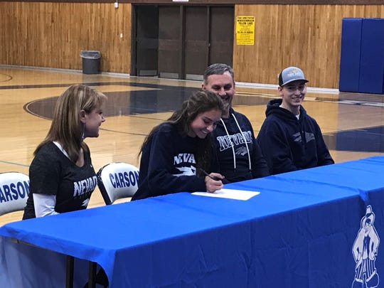 Carson senior Rheanna Jackson, shown with her family, signed to run cross country and track for Nevada in a ceremony at Carson on Wednesday.