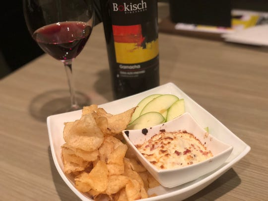 The warm Gorgonzola and bacon dip at Vino Cellars comes