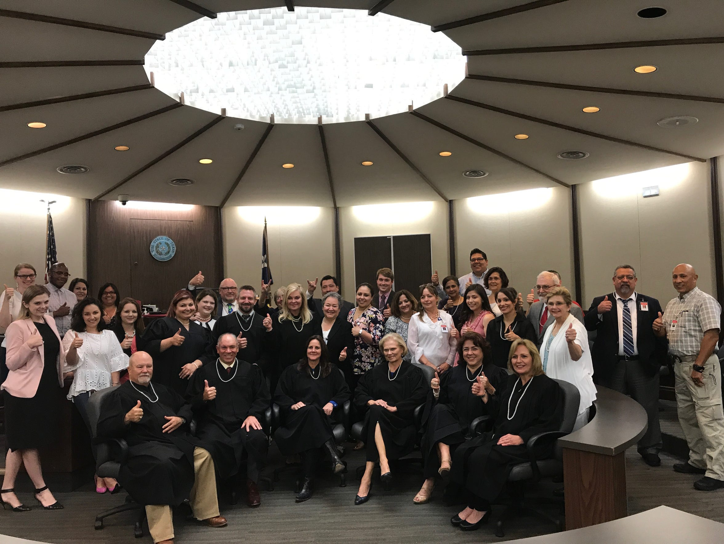 Judges and legal professionals wear pearls in honor