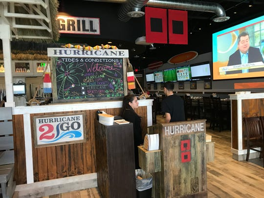 Hurricane Sports Grill combines the look of a surf shop with a sports bar.