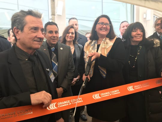 Ribbon cutting at Thursday's grand opening of Curaleaf's medical marijuana dispensary in Newburgh, New York.