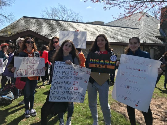 Students, moms, teachers and activists participate in Day of Action in Millburn on April 20, 2018.