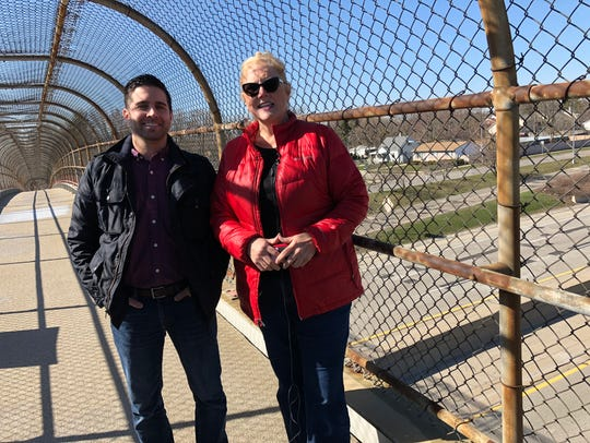 Alan Ostrowski MDOT construction project manager, left, and Diane Cross, MDOT Spokeswoman, right, standing on the overpass of I-696, where roadwork is scheduled to begin in a week on April 27, 2018, through early November.
