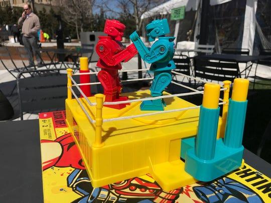 Rock 'Em Sock 'Em Robot games were set up on tables at the 'Power Up' at Beacon Park event on Friday, April 20, 2018.