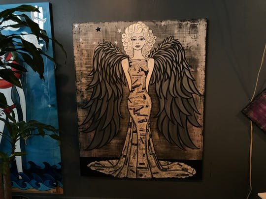 Laura Laforge's most recent piece is an angel made out of birdshot and words from magazines.