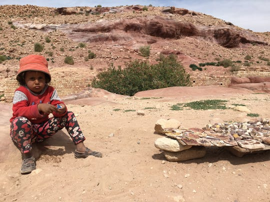 A young merchant in Petra with her wares