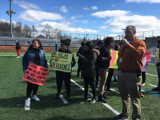 Poughkeepsie High School students stand on the football