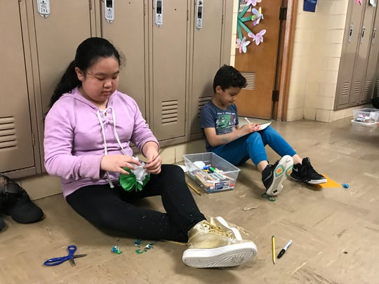 Aldo Leopold Community School students Julia Yang and Chase West take part in Green Bay School District's Day of Kindness.
