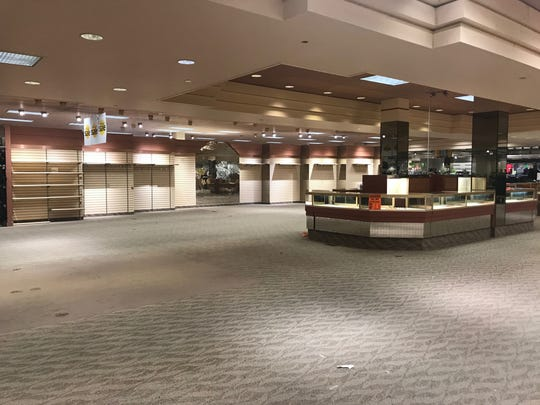 A portion of Younkers sits empty, as liquidation sales empty out the building.