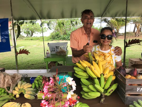 Talofofo Mayor Vicente S. Taitague and his wife, Juanita, sell bananas at the 9th Annual Talofofo Banana Festival at Ipan, Talofofo.