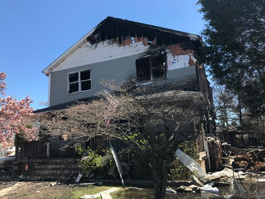 A fire burned two homes in Middletown early Sunday.