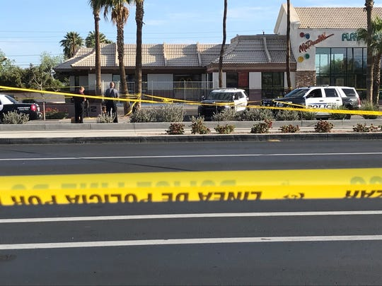 Police tape blocked off the street where officers were involved in a shooting April 22, 2018, near Alma School Road and Main Street in Mesa.