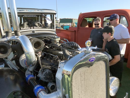 "A 1,096-horsepower, triple turbo ""Fodge"" receives admiring glances Saturday at a Kool April Nites' gathering at Big League Dreams. The diesel vehicle, owned by Larry and Trish Strawn of Redding, has a 1931 Model A Ford body on Dodge running gear."