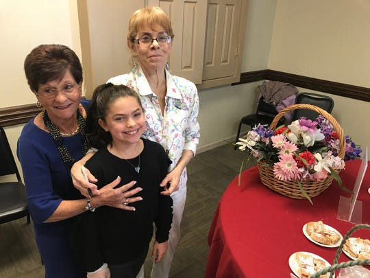 June Vegh, right, with Angelina and Bernie Masci selling sweets at the IASC Pasta Fundraiser