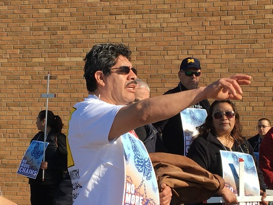 Pablo Tapia, co-founder of La Asamblea de Derechos Civíles, directs the crowd before the emancipation walk on Sunday, April 22, 2018.