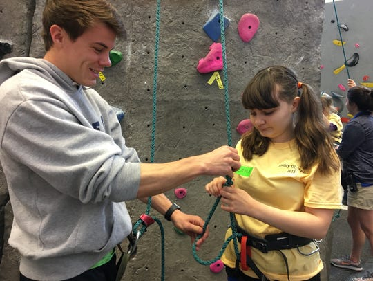 Emma Calello gets ready to climb the rock wall with